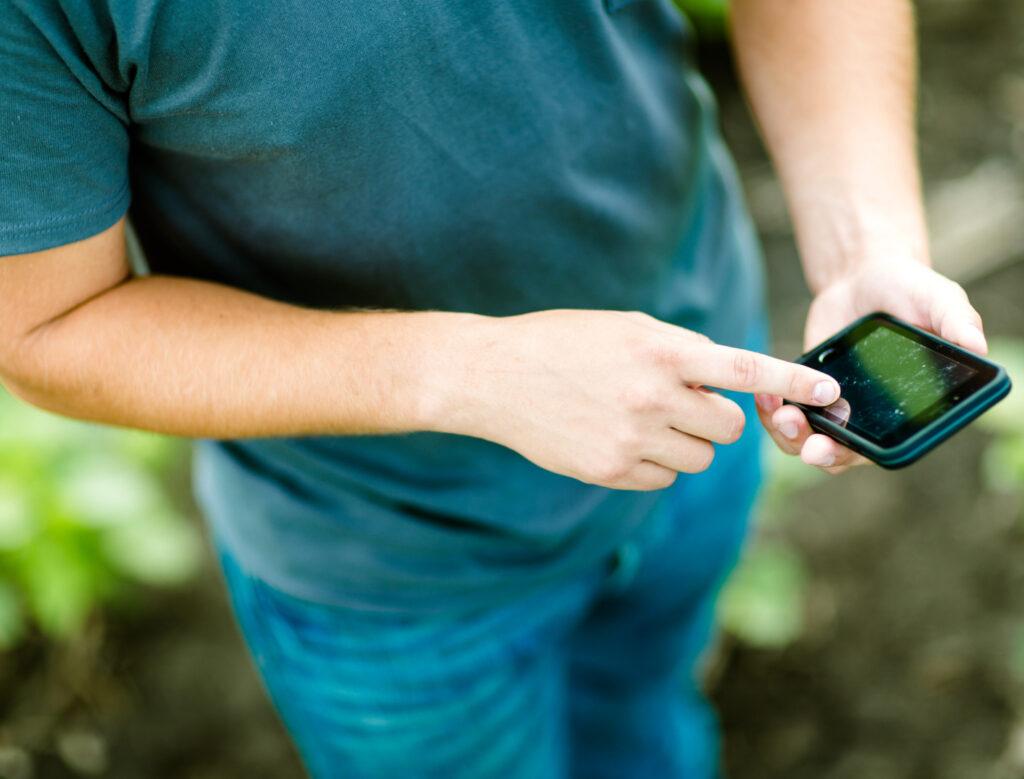 Man Scrolling on Phone using Run Time Technology