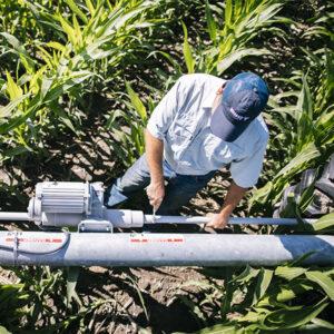 Farmer working on Center Pivot